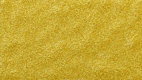 金子闪烁光亮的抽象背景 质感粗糙的金黄闪烁表面 库存图片