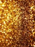 金子闪烁背景 库存照片