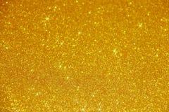 金子闪烁闪闪发光背景-储蓄照片 免版税库存图片
