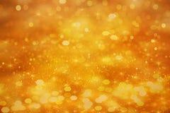 金子闪烁bokeh作用背景一个假日 免版税库存照片