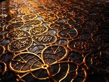 从金子颜色的样式的织地不很细布料 库存照片