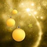 金子Xmas电灯泡装饰贺卡 免版税库存图片