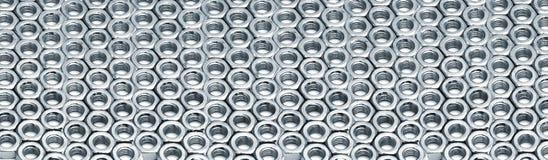 金属六方形螺母行  免版税库存图片