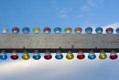 金属化与电灯的横幅在多云天空 免版税库存图片