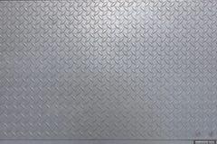 金属化与织地不很细表面金刚石样式的合金板料 库存图片