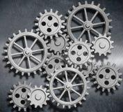 金属化与齿轮和嵌齿轮3d例证的背景 库存照片