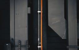 金属构造背景橙色管道 图库摄影