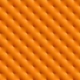 金属橙色无缝的背景 免版税图库摄影