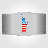 金属片与U S 旗子和自由女神象 7月4日 美国的独立日 免版税库存照片