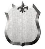 金属盾尾花标志 库存照片