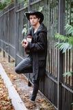 金属篱芭 音响详细资料吉他吉他弹奏者递instrumant音乐执行者使用 库存照片