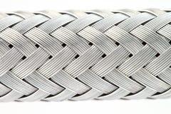 金属线的纹理把被加强的水管编成辫子 库存照片