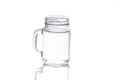 金属螺盖玻璃瓶用在白色隔绝的水 免版税库存图片