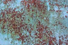 金属表面上的蓝色破裂的绘画 图库摄影