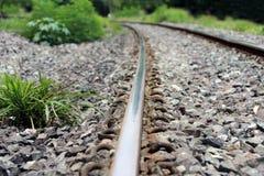 金属铁轨和岩石在泰国 库存照片