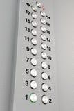 金属镀铬物电梯按钮 免版税库存照片