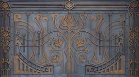 金属门装饰的华丽加工铁元素 库存照片