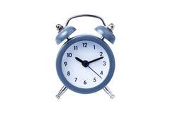 金属闹钟在白色背景上午10点的工作时间 图库摄影