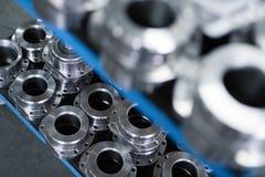从金属零件的工业背景在金属工业生产了 免版税图库摄影