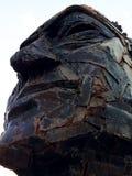 金属面孔雕塑 库存照片