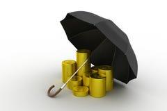 金币在一把黑伞下 免版税库存照片