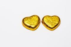 金心脏在白色背景的巧克力糖孤立 库存照片