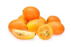 金桔,在白色背景隔绝的cumquat果子 图库摄影