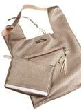 金棕色软的皮革妇女的袋子 免版税库存图片