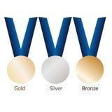金牌,银牌,在蓝色丝带的铜牌与发光的金属表面 免版税图库摄影