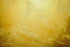 金石背景和梯度阴影 纸装饰元素的美丽的明亮的黄铜墙壁 金黄发光的黄色的叶子 免版税库存照片