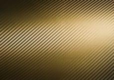 金碳纤维纹理 免版税库存照片