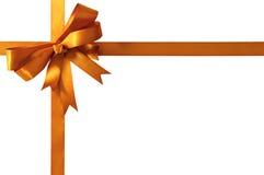 金礼物在白色背景隔绝的丝带弓 图库摄影