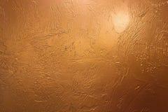 金背景或纹理和梯度阴影 发光的黄色叶子金箔纹理背景 金背景资料,纹理是 免版税图库摄影