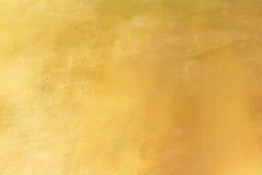 金背景或纹理和梯度阴影 免版税库存照片