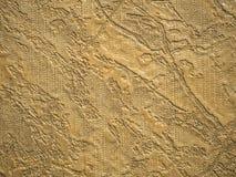 金背景纹理,在墙壁上的墙纸 图库摄影