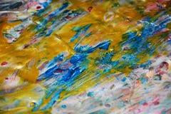 金蓝色弄脏了蜡桃红色闪耀的背景,水彩生动的背景,纹理 免版税库存图片