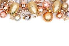 金装饰品圣诞节顶面边界在白色隔绝的 免版税库存照片