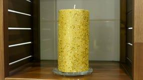 金装饰蜡烛 图库摄影