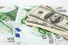 金钱、欧元和美元在白色背景 免版税库存照片
