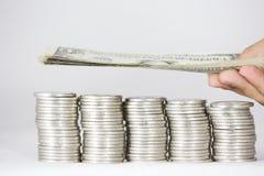 金钱、硬币和钞票 图库摄影