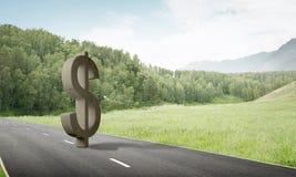 金钱做和财富概念由在柏油路的石美元标志提出了 免版税库存图片