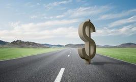 金钱做和财富概念由在柏油路的石美元标志提出了 库存照片