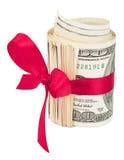 金钱卷与一把红色弓的 免版税库存照片