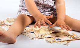 金钱和孩子 库存图片
