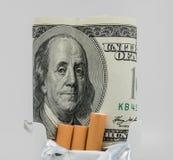 金钱和烟草 库存照片
