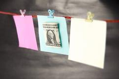 金钱和笔记 库存图片