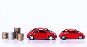 金钱和红色汽车 库存照片