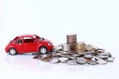 金钱和红色汽车 图库摄影