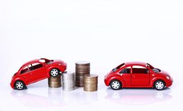 金钱和红色汽车 库存图片