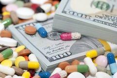 金钱和药物 库存照片